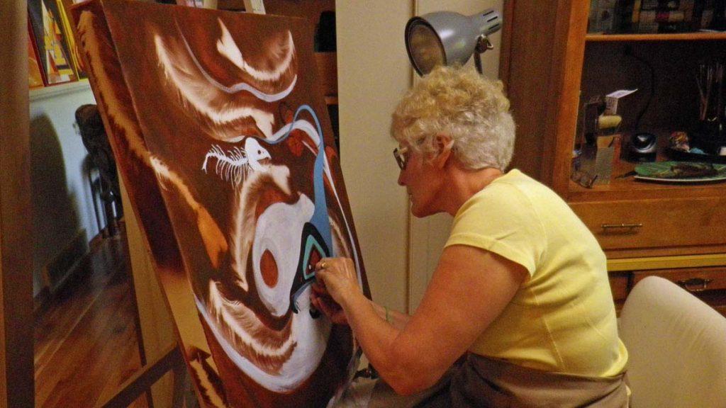 © Bev Mazurick - Artist at easel painting Salmon Boy
