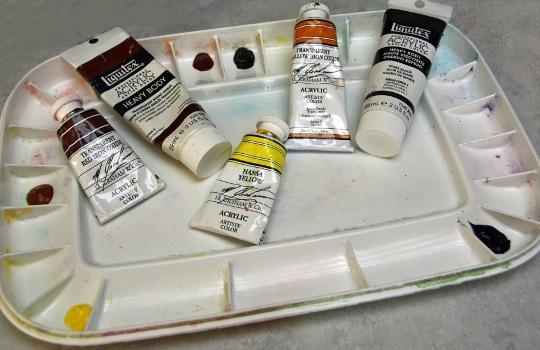 Plastic welled palette of unmix tube colours